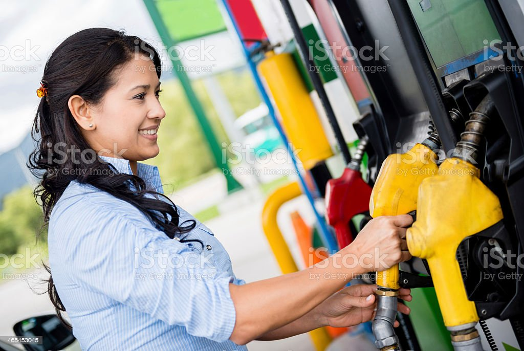 Woman at the gas station stock photo