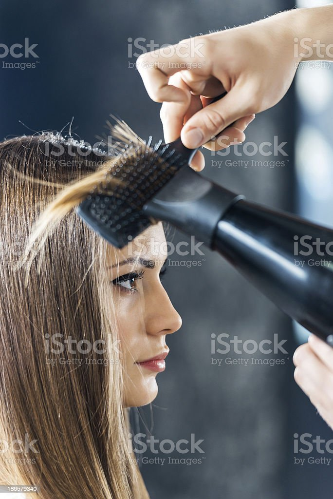 Woman at the hair salon. stock photo