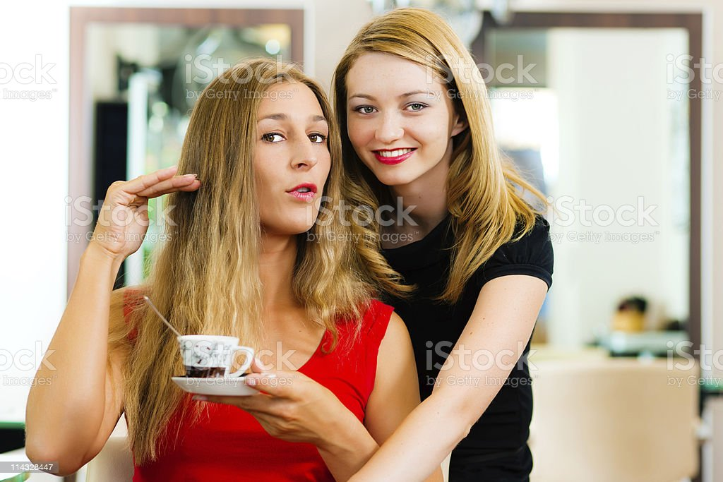 Woman at the hairdresser getting advise royalty-free stock photo