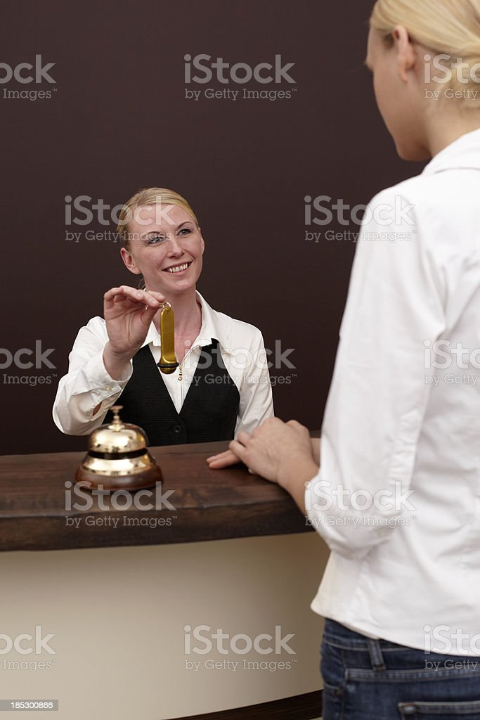 Woman at the hotel reception royalty-free stock photo
