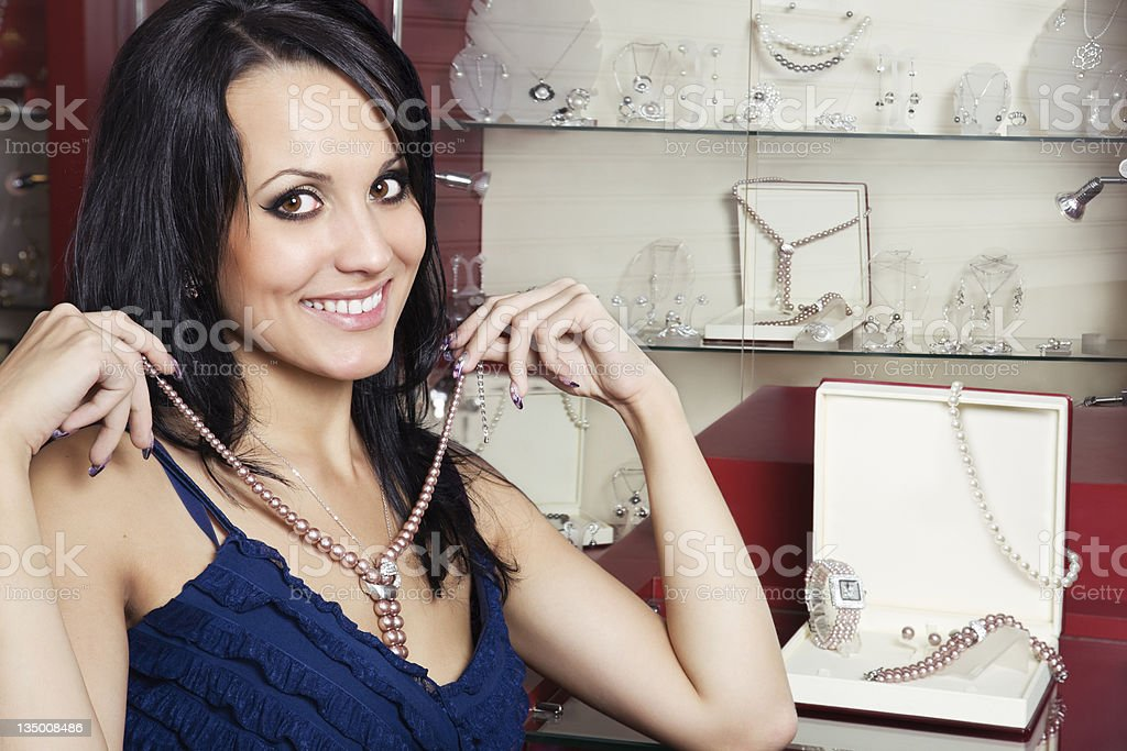 Woman at the jewellry store stock photo