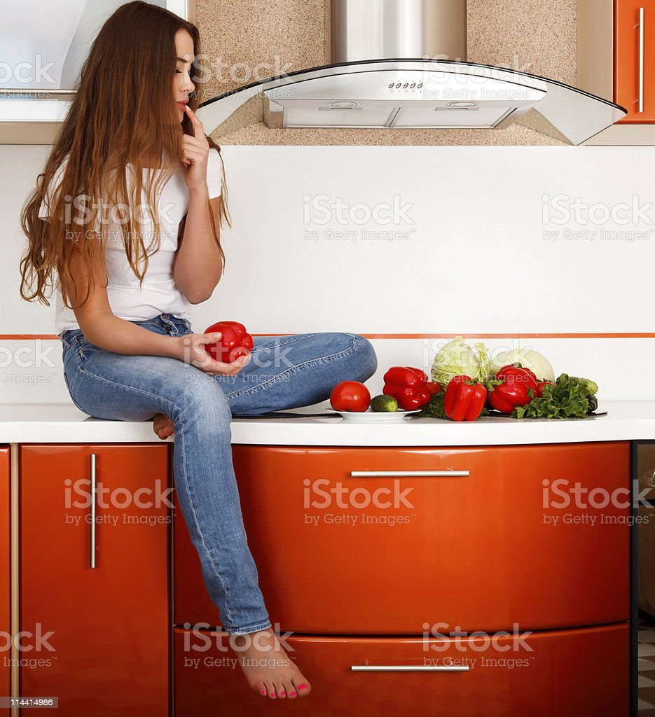 Woman at the kitchen royalty-free stock photo