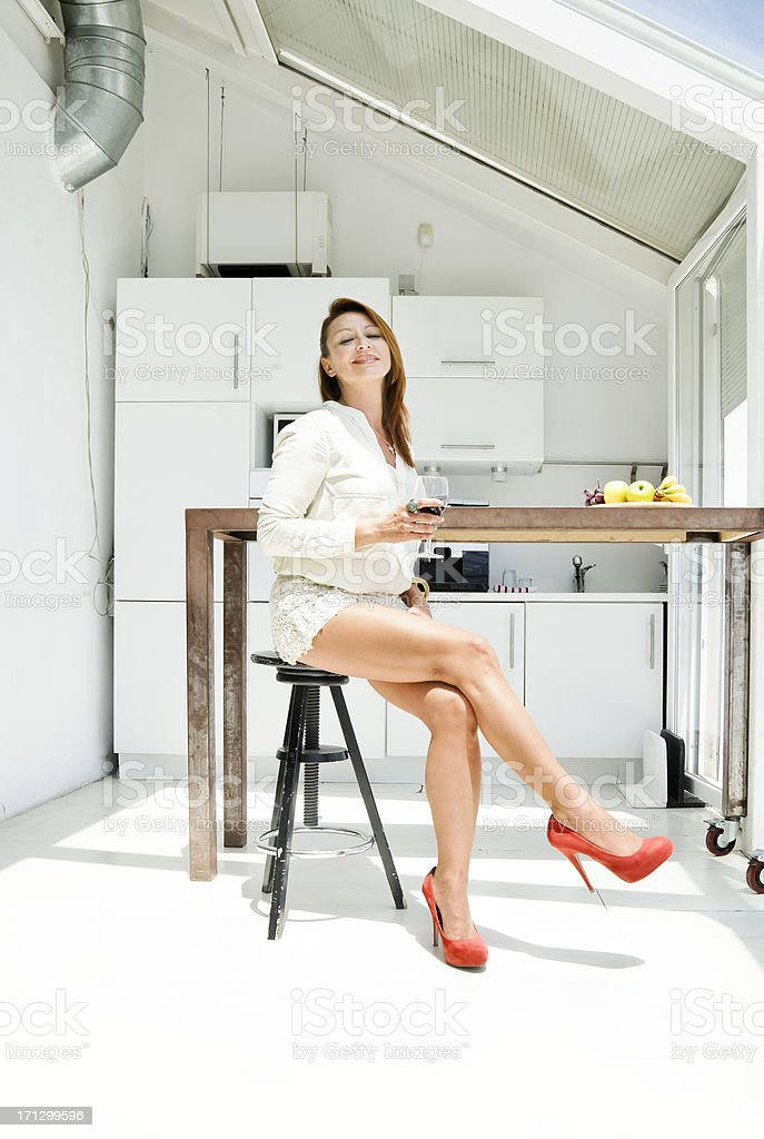 Woman at the kitchen. stock photo