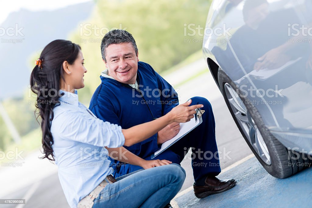 Woman at the mechanic royalty-free stock photo
