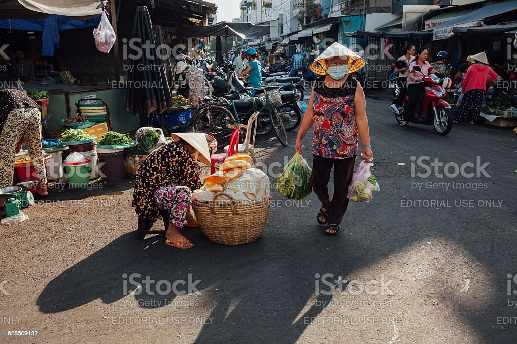 Woman at the morning market, Vietnam stock photo
