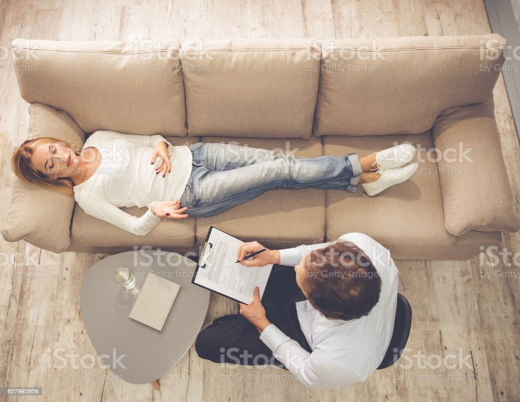 Woman at the psychologist stock photo