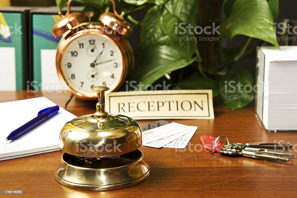 woman at the reception of a hotel checking in royalty-free stock photo