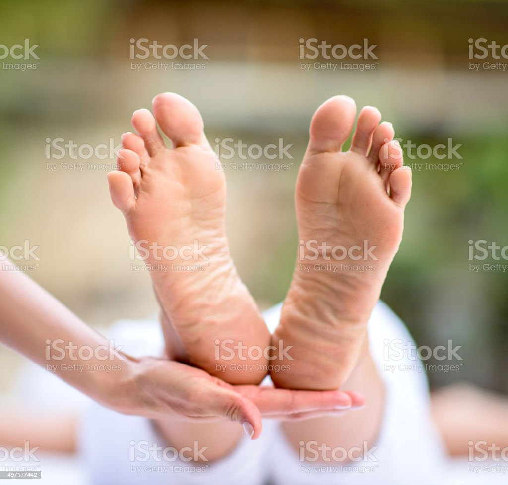 Woman at the spa getting a pedicure stock photo