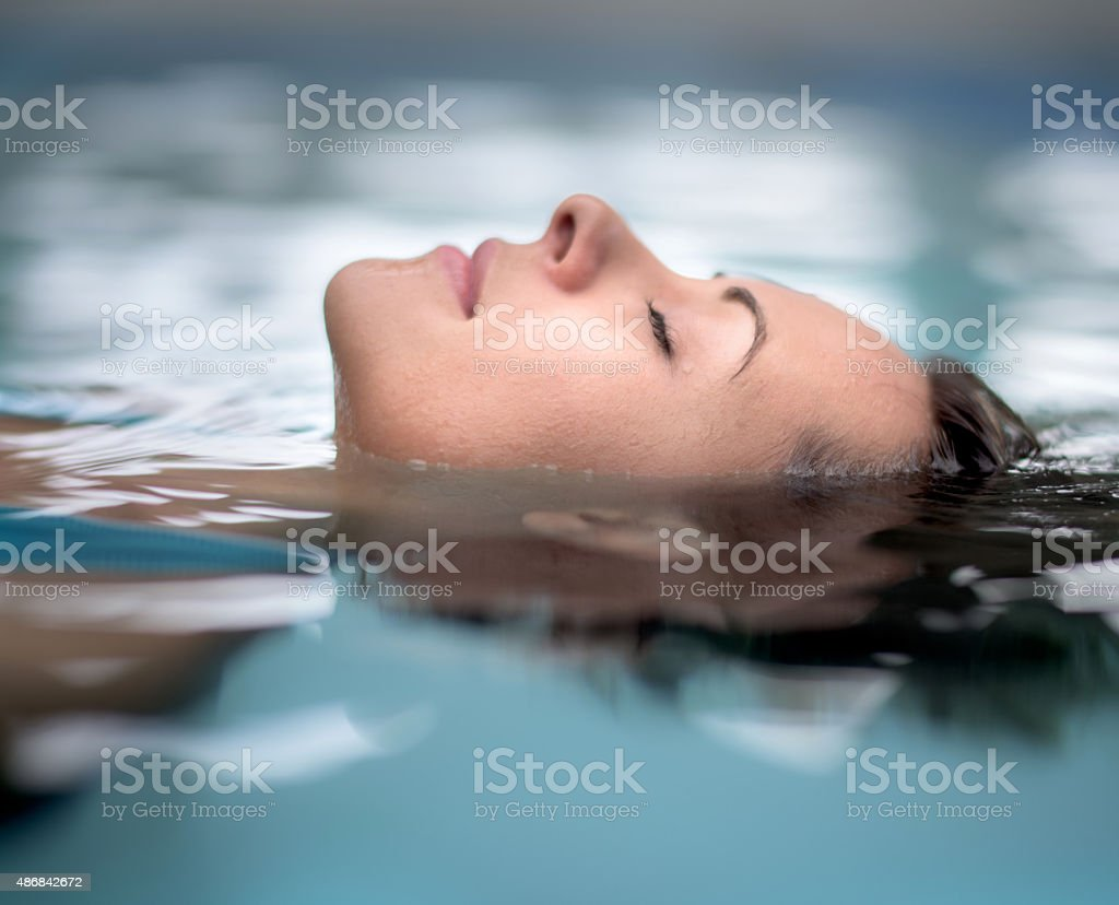 Woman at the spa relaxing at the swimming pool stock photo