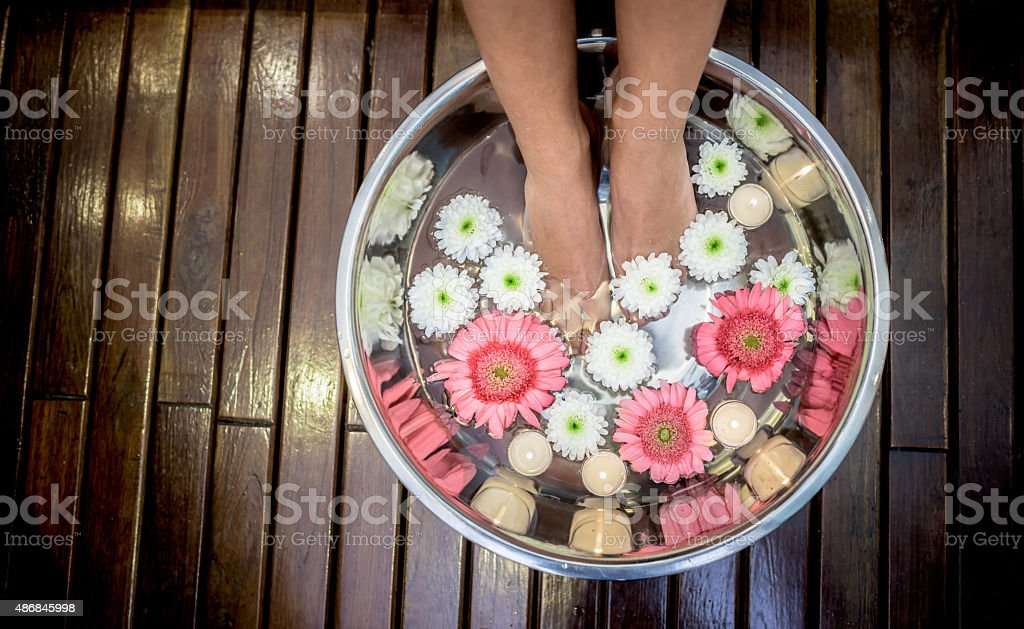 Woman at the spa with feet in water stock photo