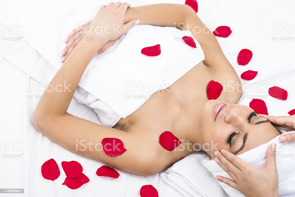 Woman at the spa with rose petals royalty-free stock photo