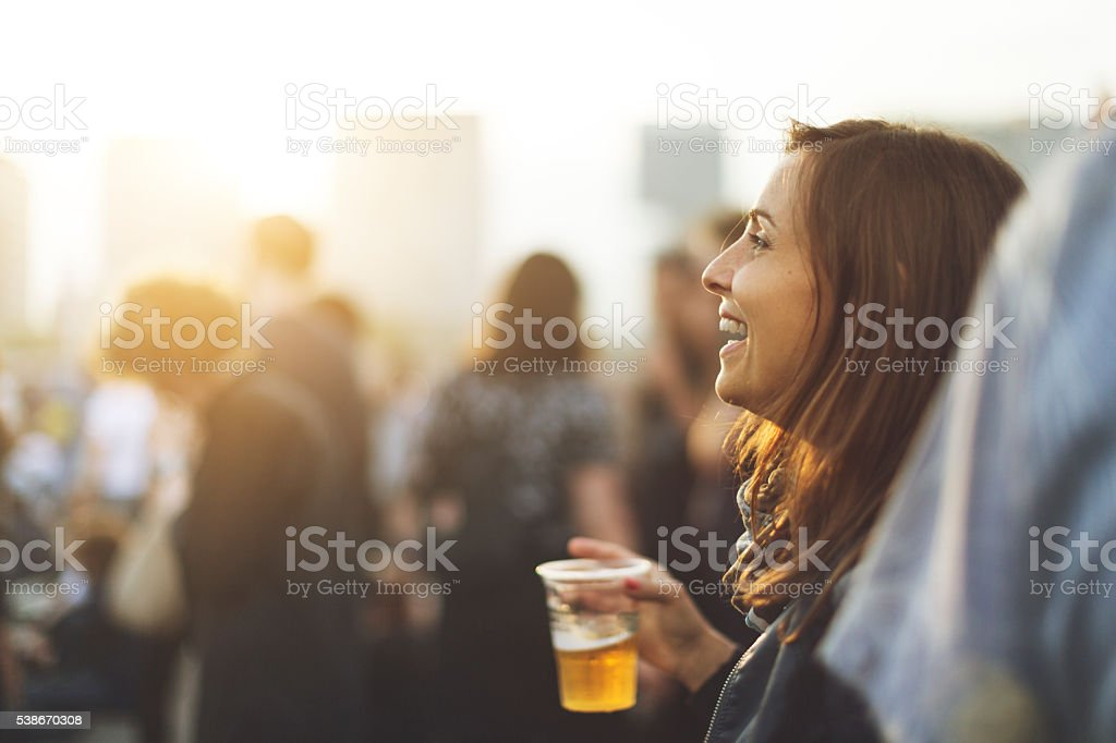 Woman at the summer music festival stock photo
