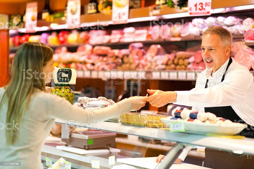 Woman at the supermarket giving her number to the cashier stock photo