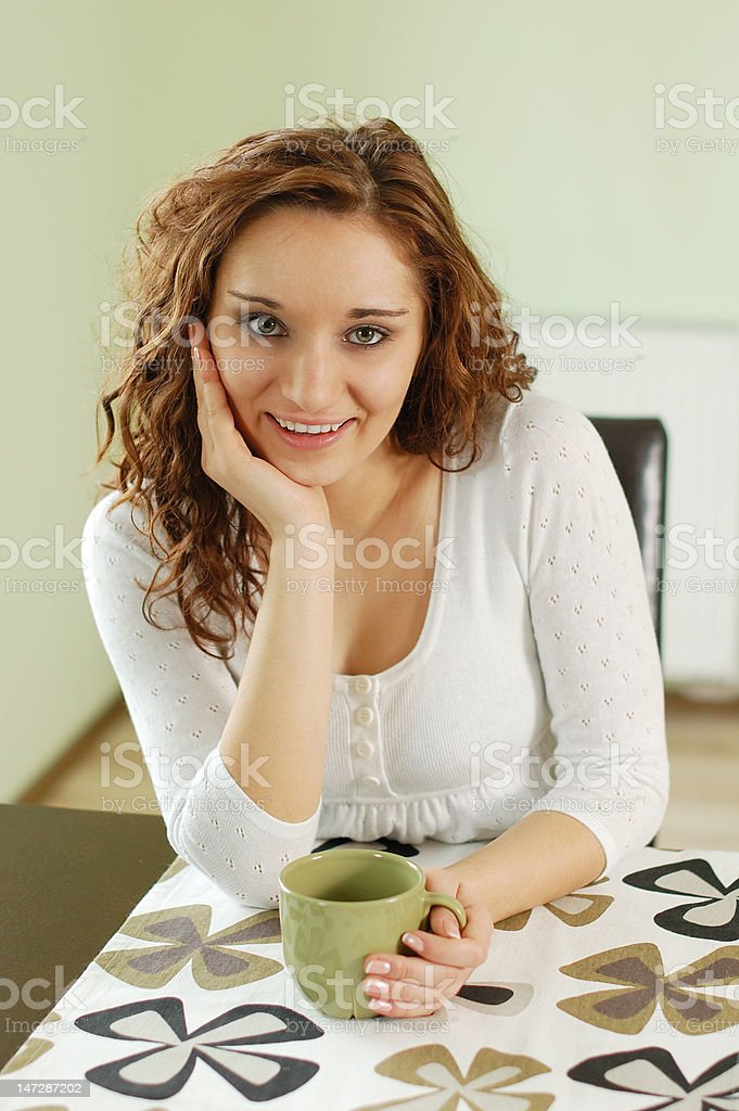 Woman at the table royalty-free stock photo