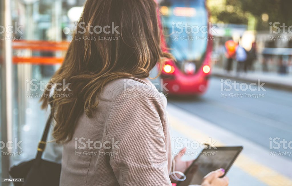 Woman At The Tram Stop stock photo