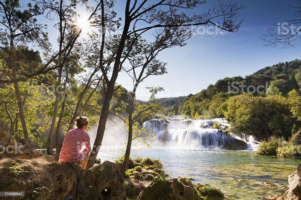 Woman at the waterfalls stock photo