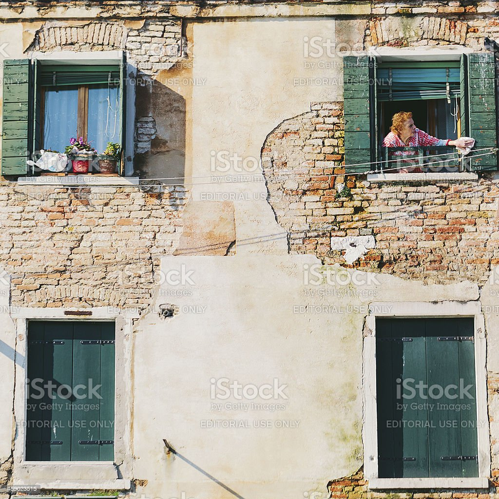 Woman at the Window in Italy royalty-free stock photo