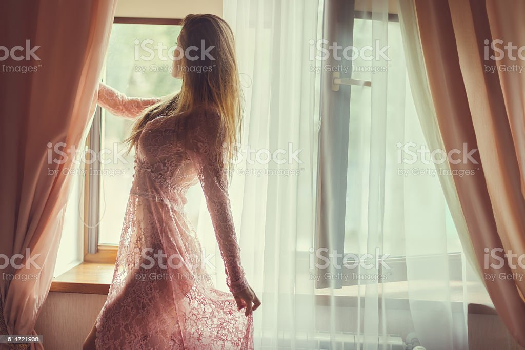 Woman at the window. stock photo