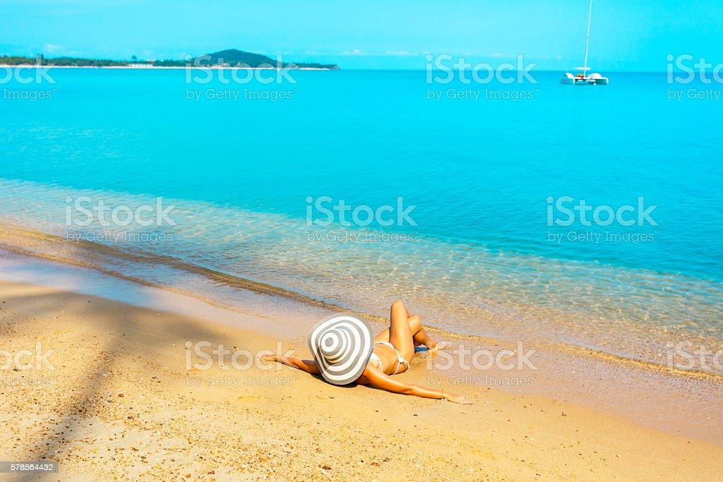 Woman at tropical beach stock photo