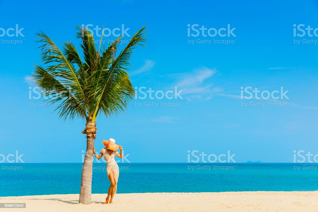 Woman at tropical beach stock photo