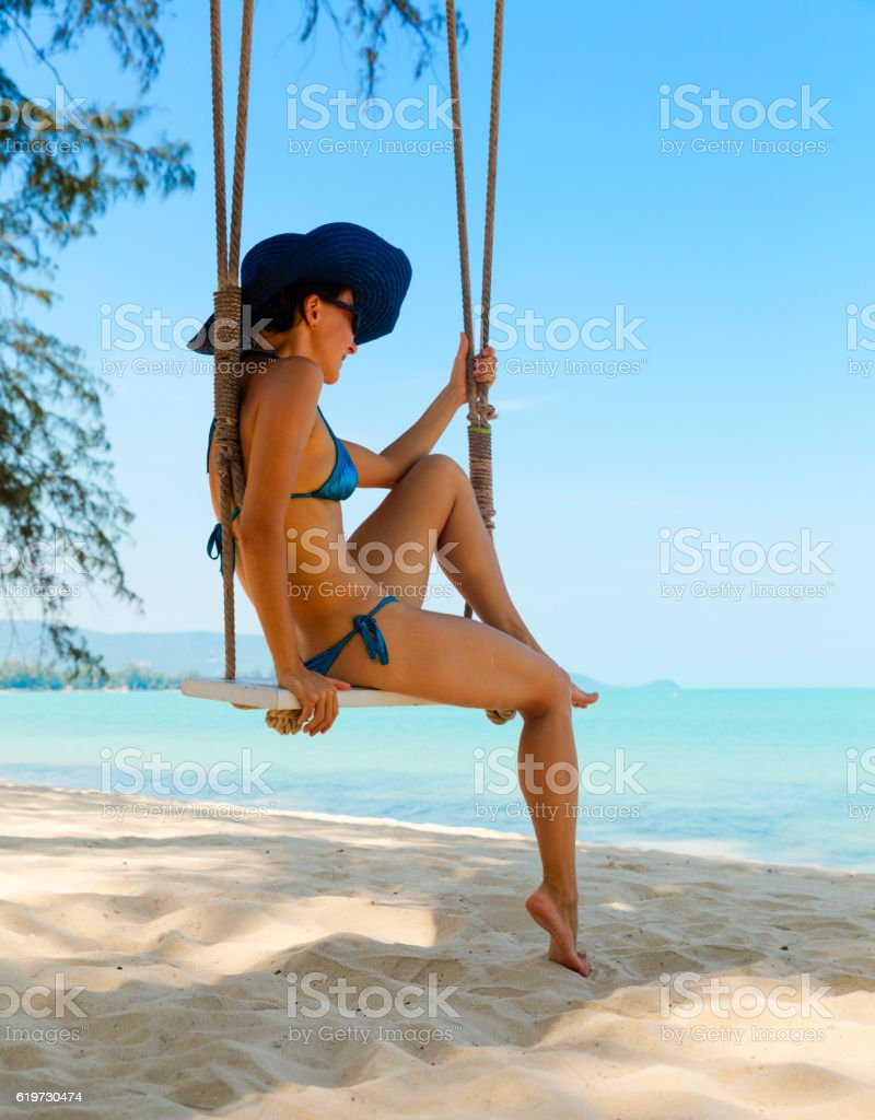 Woman at tropical swing stock photo