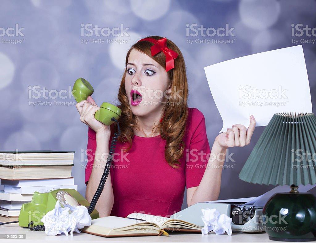 Woman at typewriter on telephone royalty-free stock photo