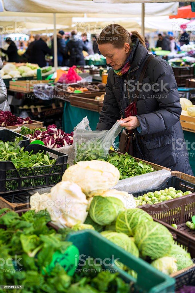 Woman at vegetable market in Ljubljana, Slovenia stock photo