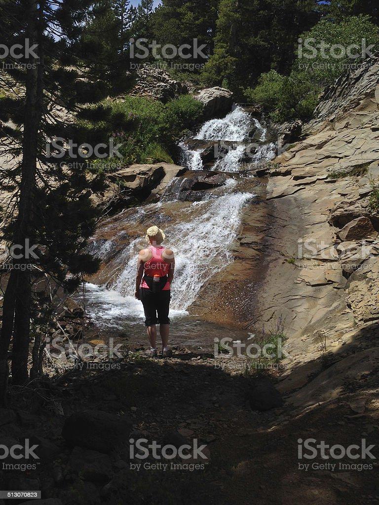 Woman at Waterfall royalty-free stock photo