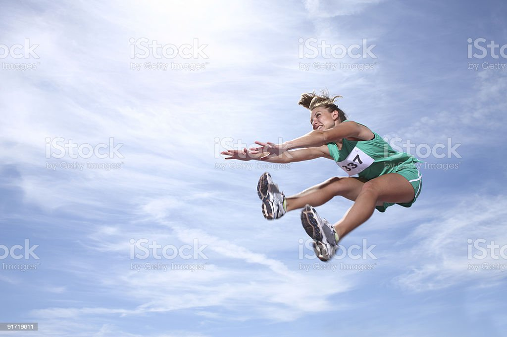 Woman athlete jumping royalty-free stock photo