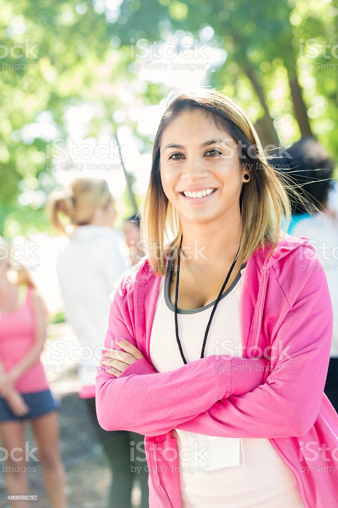 Woman attending race to raise money for breast cancer research stock photo