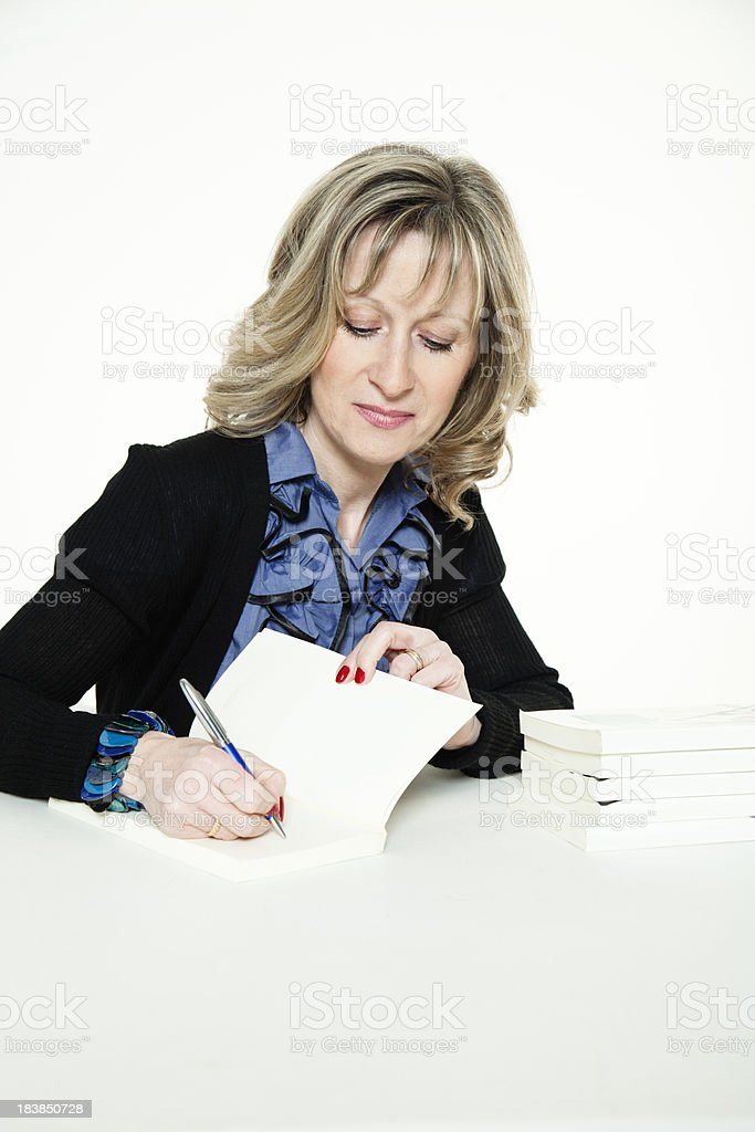 Woman author signing books royalty-free stock photo