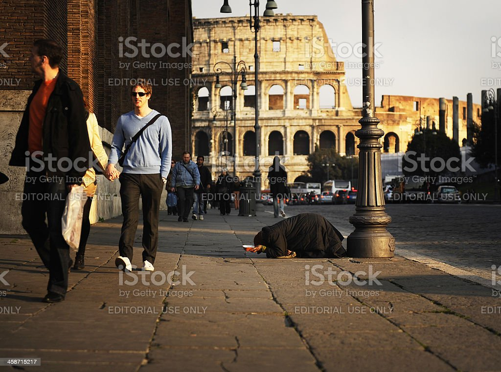 Woman awaiting charity - Beggar in Rome royalty-free stock photo