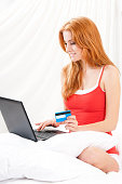 Woman awaking with notebook at bedroom