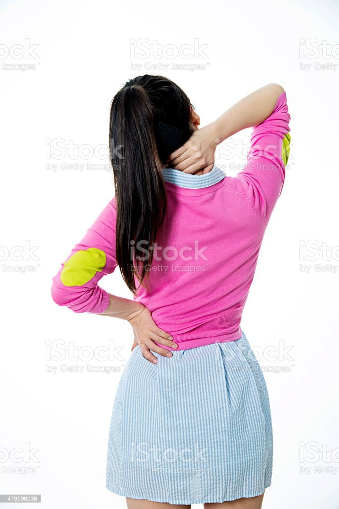 Woman back and neck pain stock photo