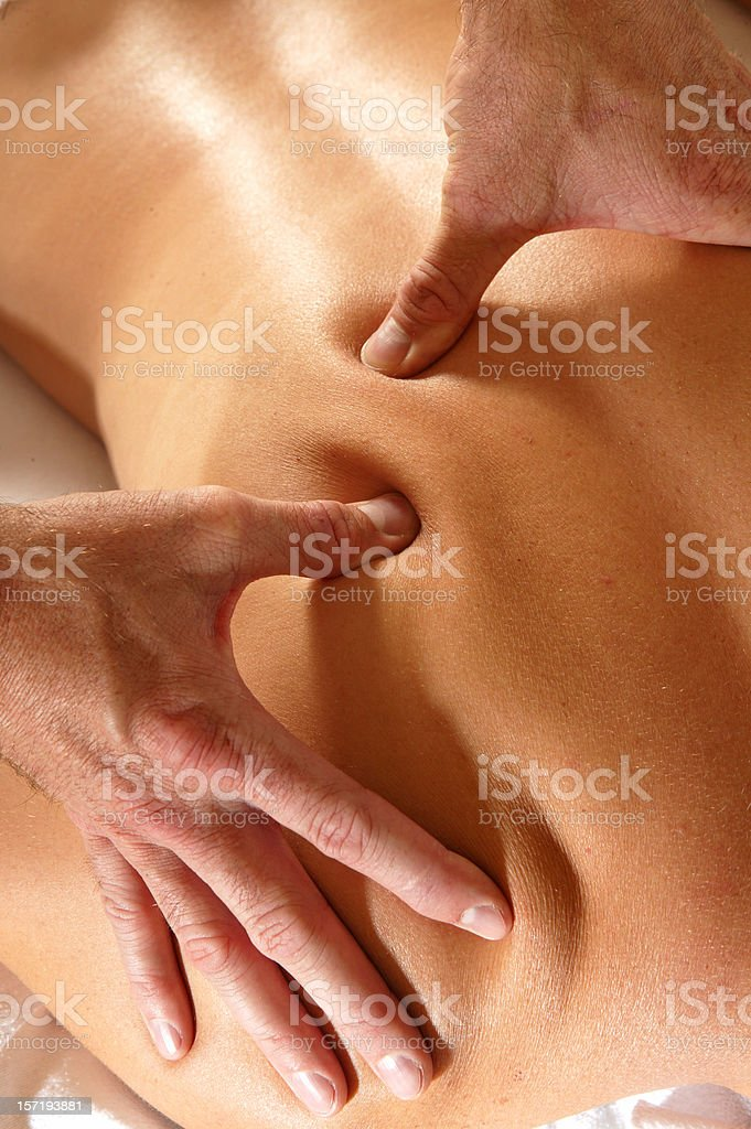 woman back getting a massage royalty-free stock photo