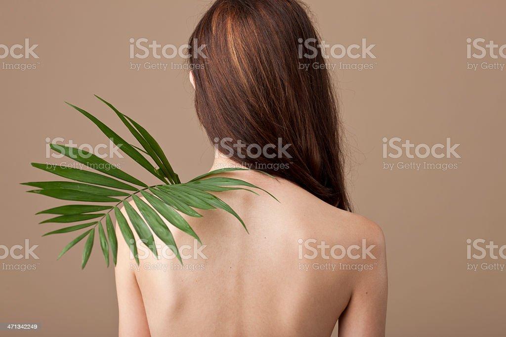 woman back holding fern leaf royalty-free stock photo