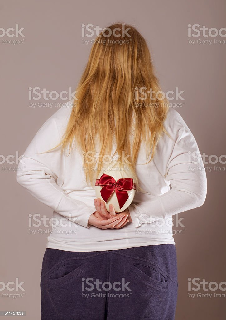 Woman back portrait with easter egg. stock photo