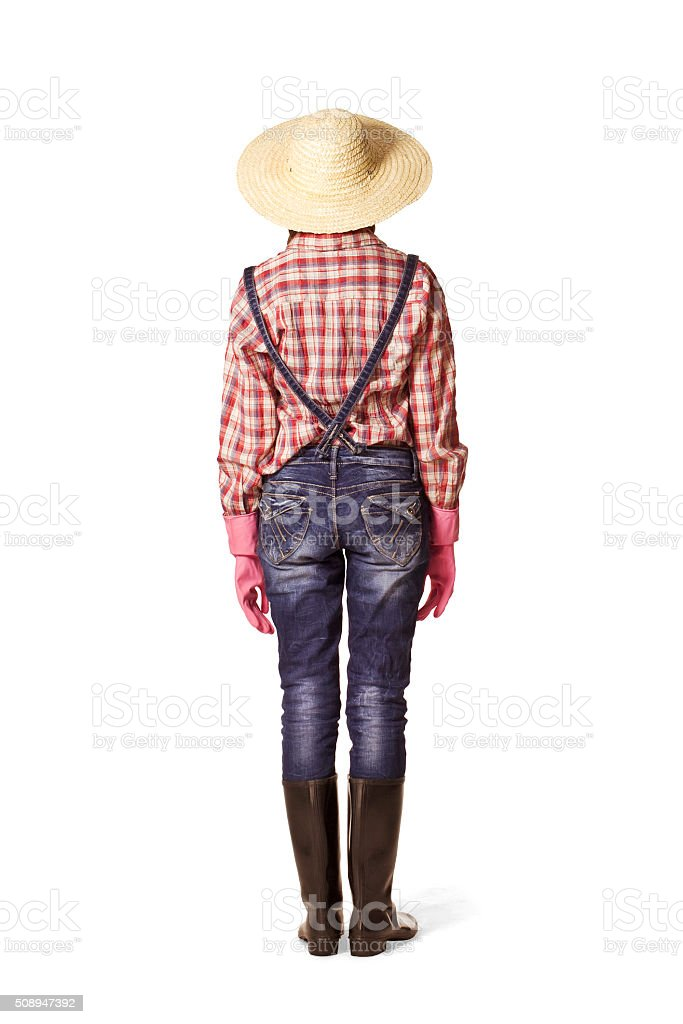 Woman back portrait with hat, dungarees and wellingtons. stock photo