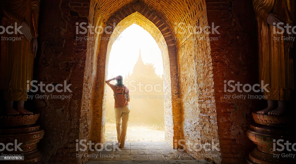 woman backpacker looking on sunset and enjoy the view  temples stock photo