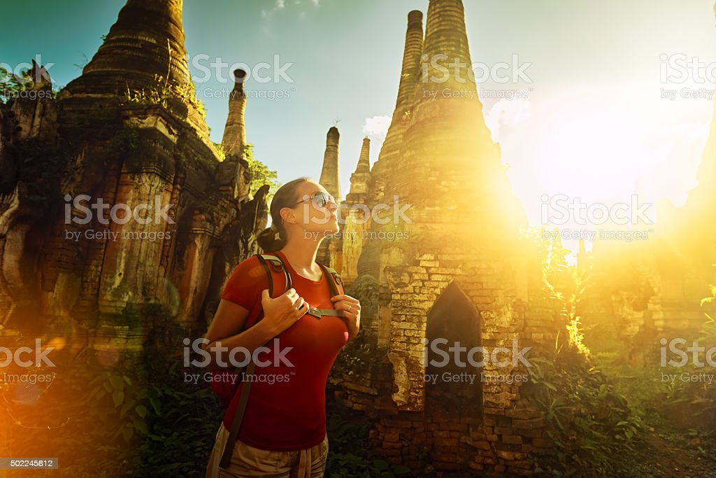 Woman backpacker traveling  with backpack and enjoying sunset vi stock photo