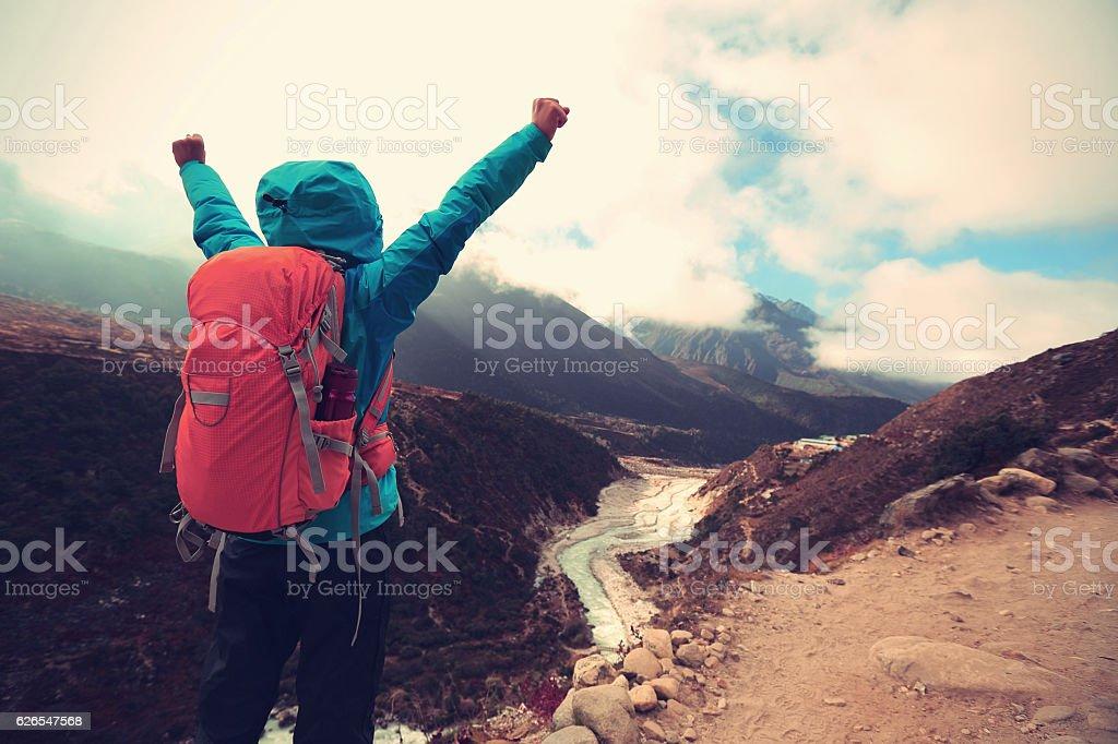 woman backpacker trekking at the himalaya mountains stock photo