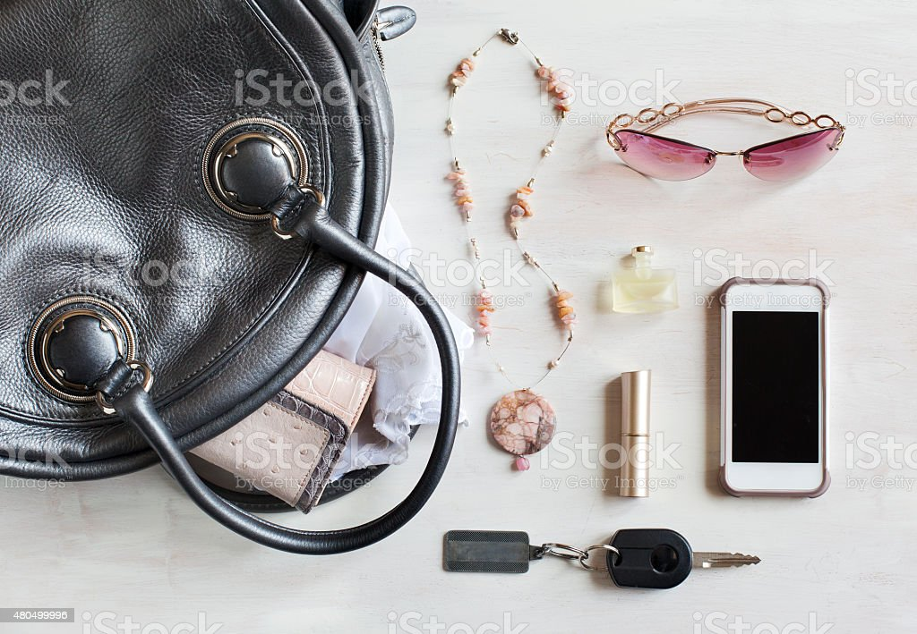 Woman bag and accessories stock photo