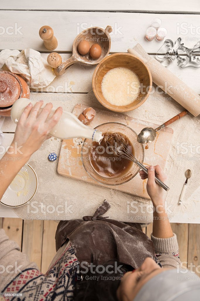 Woman baking Christmas cookies in her kitchen stock photo