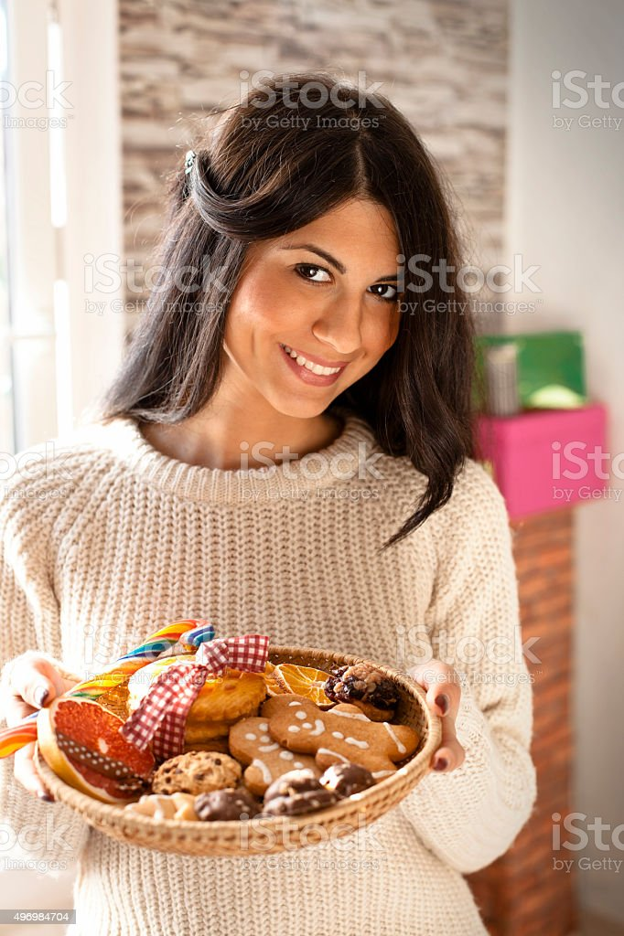 Woman Baking Christmas Cookies stock photo