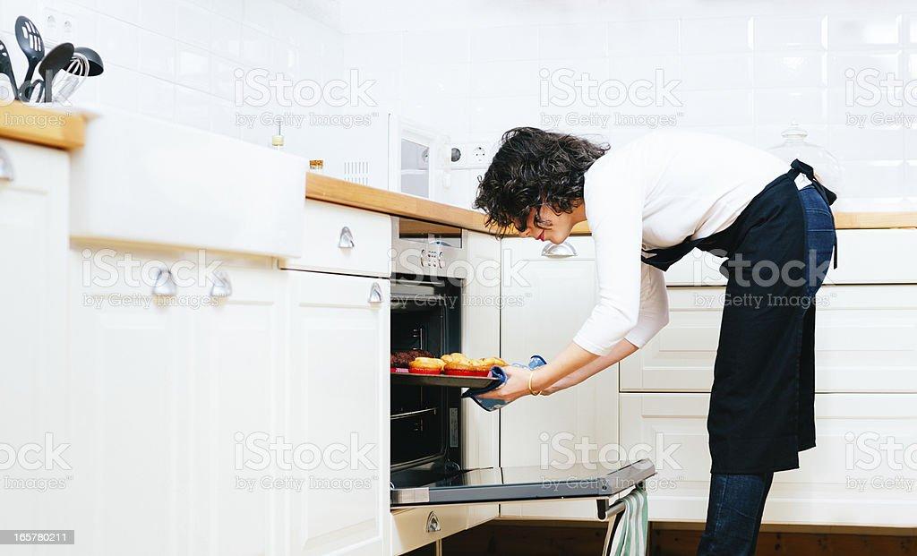 Woman Baking Cupcakes stock photo
