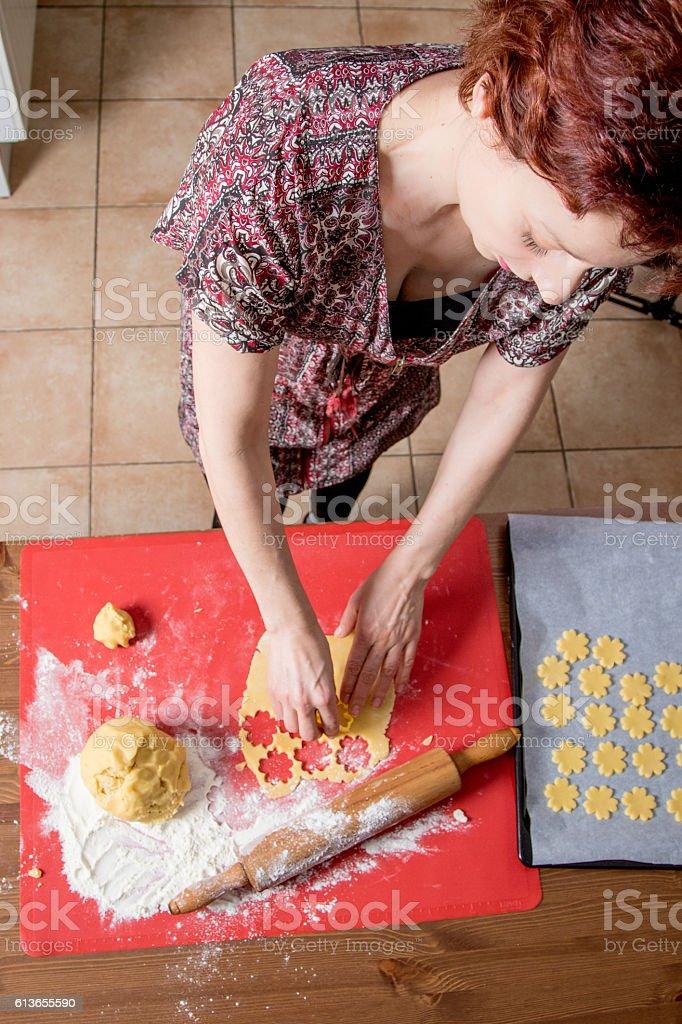 Woman baking homemade Christmas cookies stock photo