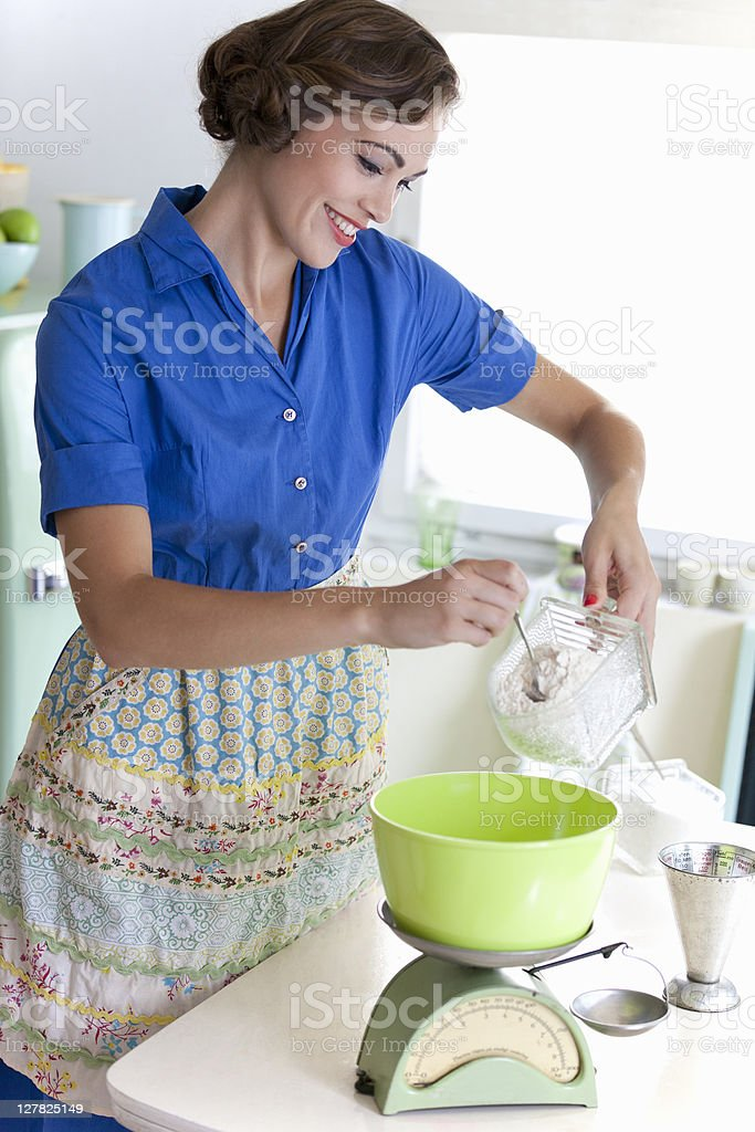 Woman baking in kitchen royalty-free stock photo