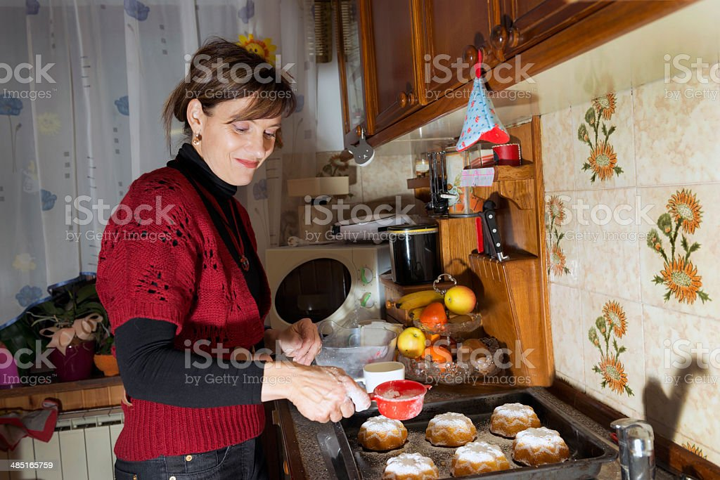 Woman Baking Muffins at Home, Slovenia, Europe royalty-free stock photo