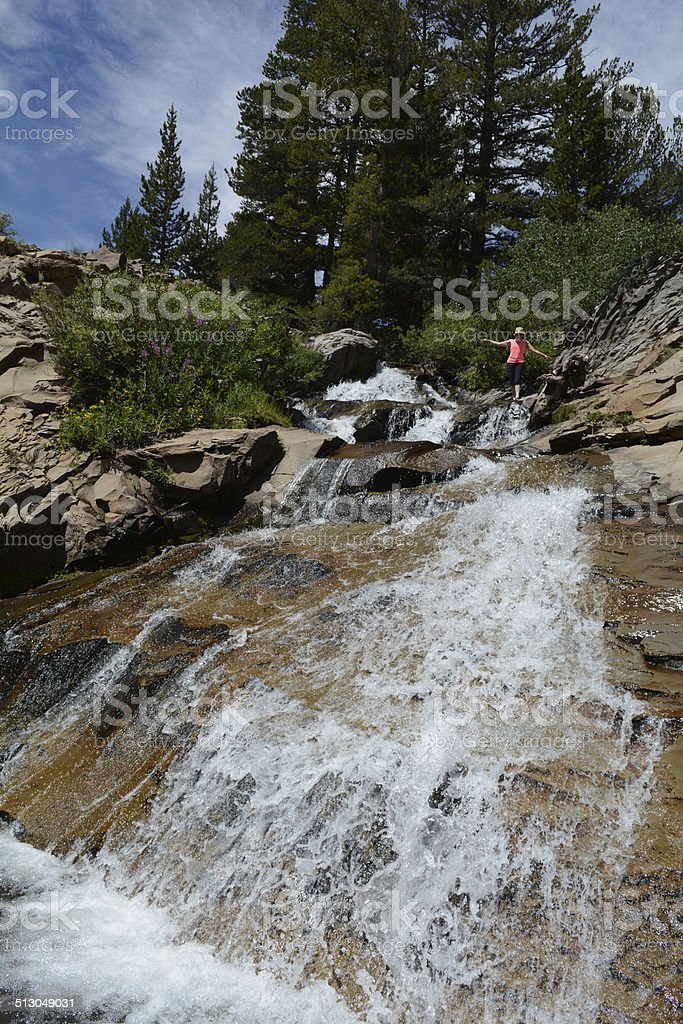 Woman Balancing by a Waterfall royalty-free stock photo