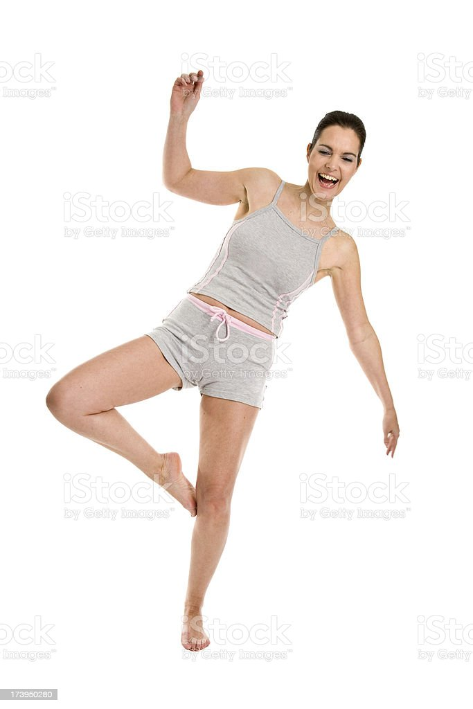 Woman balancing on one foot stock photo